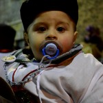 "Little devotee with traditional dress called ""u saccu"" during the Saint Agatha festival in Catania. February the 4th."