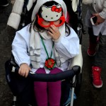 Hello kitty devotee during the Saint Agatha festival in Catania. February the 4th.