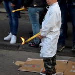 A kid devotee with a small candle, waiting for the procession during the Saint Agatha festival in Catania. February the 4th.